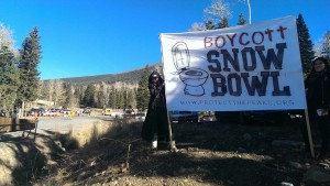 T. Tracy holding a banner at Snowbowl